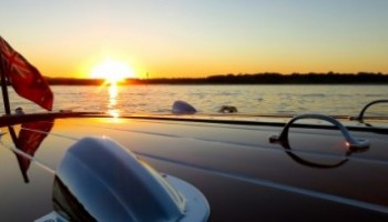 Sunset cruise to Lake Cooroibah Noosa on a classic wooden speed boat