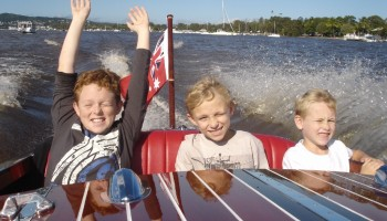 Family school holiday fun on the Noosa Dream classic wooden speed boat