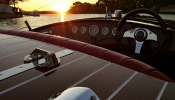 Noosa Dreamboats classic wooden speedboat ready to begin a sunset cruise in Noosa.